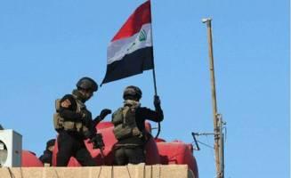 اهتزاز پرچم عراق در فلوجه پس از سه سال